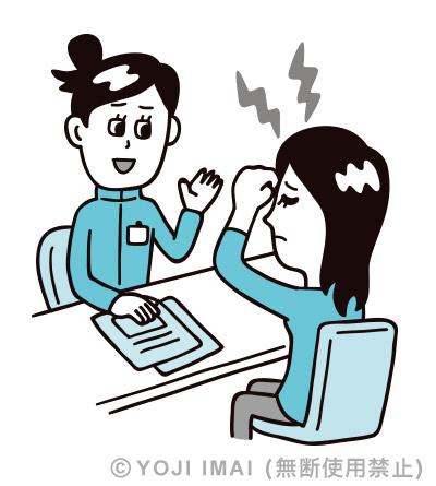 頭痛の相談を受ける薬剤師